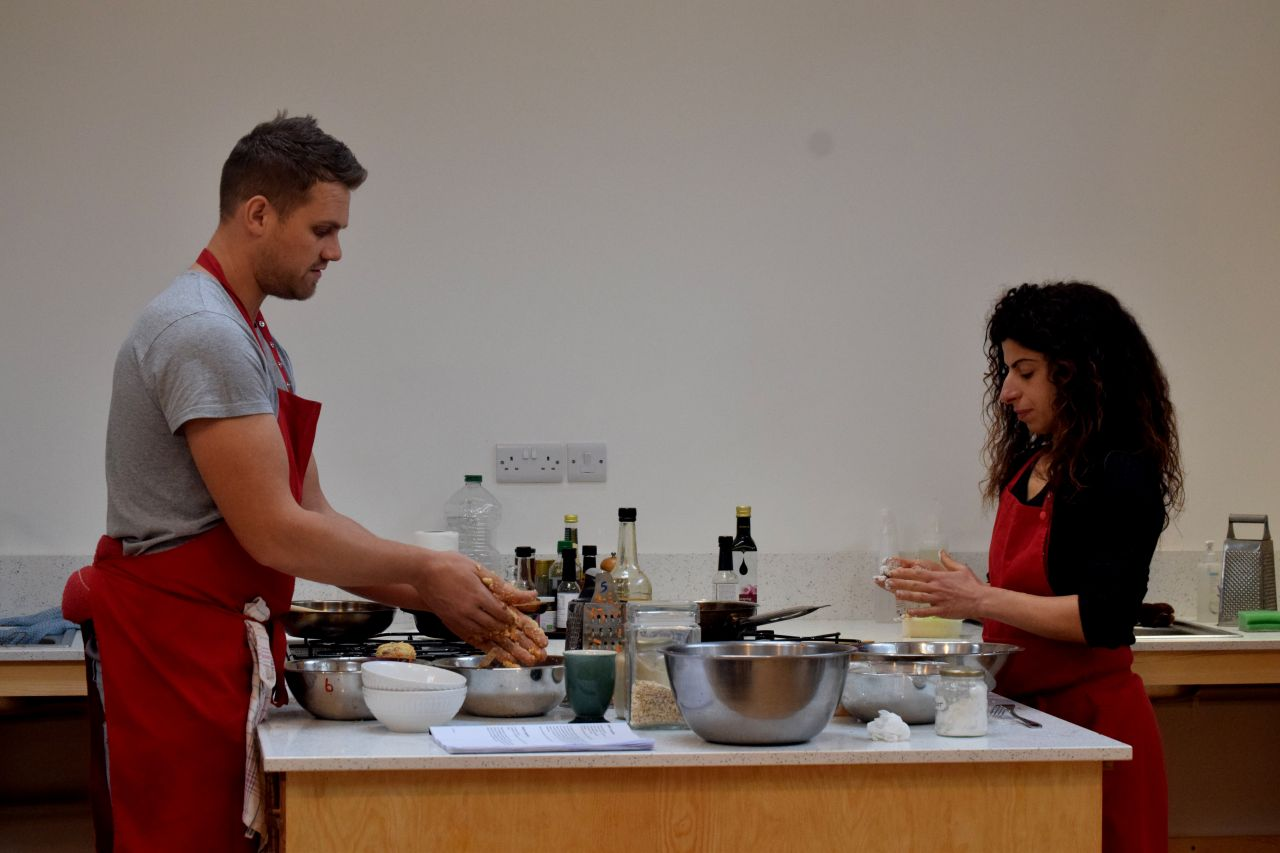 Man cooking plant based meal in new cookery school